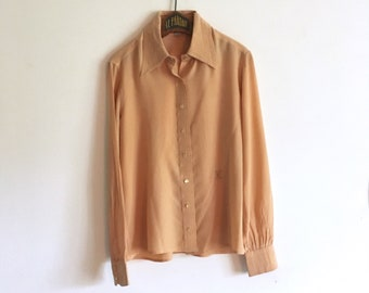 d3e7ac602770d0 70s Céline Vintage silk tan apricot blouse • embroidered logo • made in  Italy