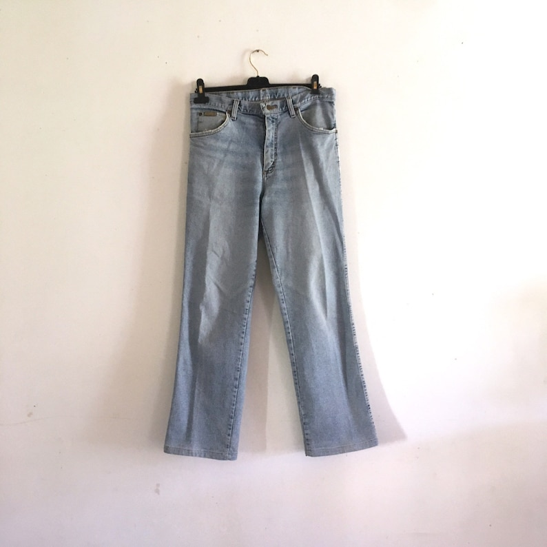59ca038d Vintage WRANGLER jeans // distressed denim waist 33   Etsy