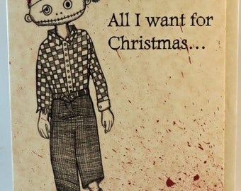Zombie Christmas Card... All I want for Christmas... is BRAINS, BRAINS, BRAINS! Festive blood splatter!