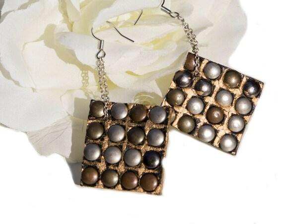 Faux leather tribal earrings by GunaDesign