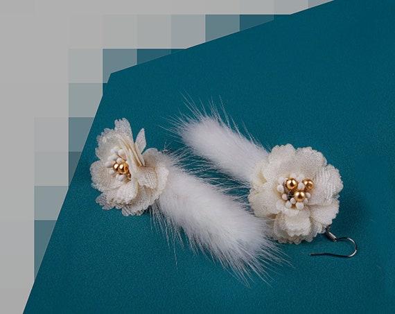 White fur tassel earrings by GunaDesign