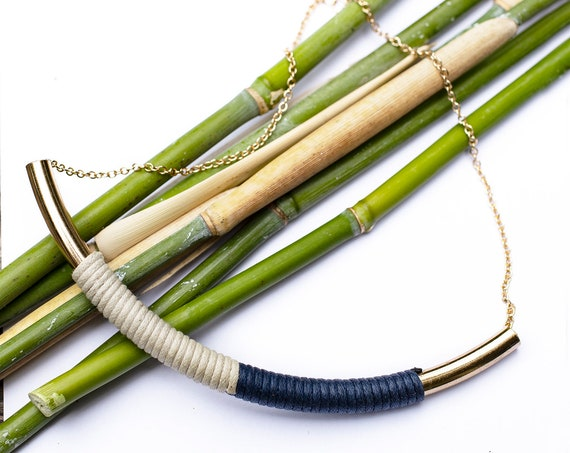 Metal and textile tube necklace by GunaDesign