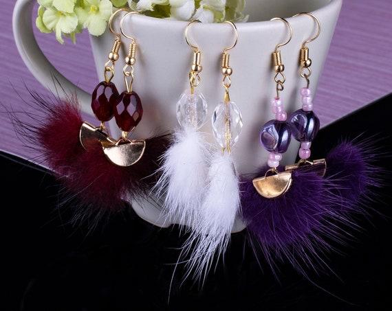 Fur tassel earrings with bead by GunaDesign