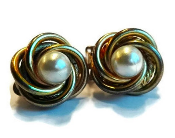 Round vintage clip-on earrings from 60's