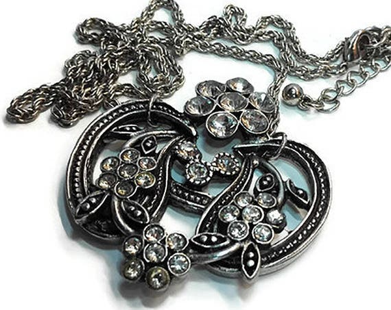 Silver color Art deco style floral metal pendant with white Rhinestone beads