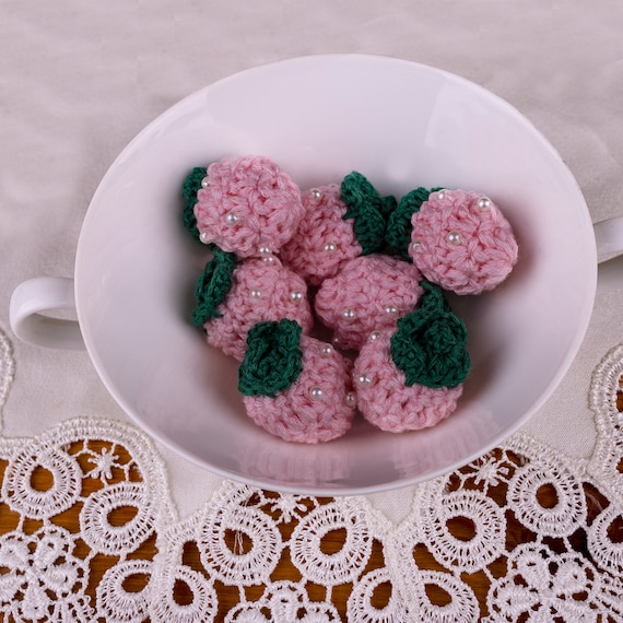 Pink crochet strawberry applique for decoration