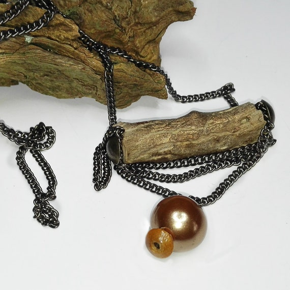 Wooden branch pendant with bead by GunaDesign