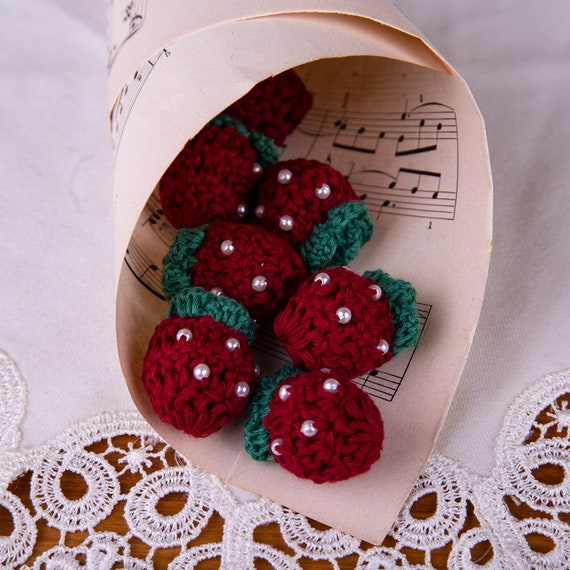 Red crochet strawberry applique for decoration