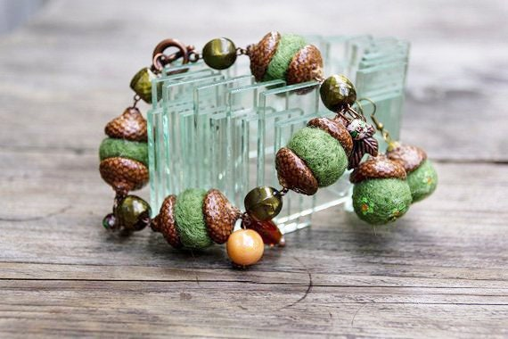 Bracelet with charms and earrings set made from felted beads and real acorn cups for woman