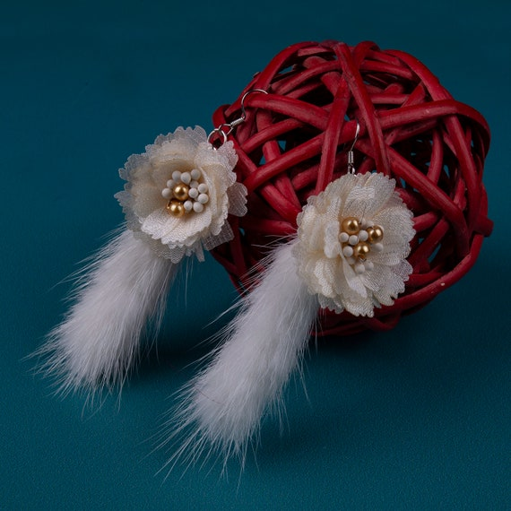 Vivid white fur tassel earrings by GunaDesign