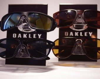 cdd3b24b2efea Magnificent remote LED Oakley Sunglasses Display Case Stand