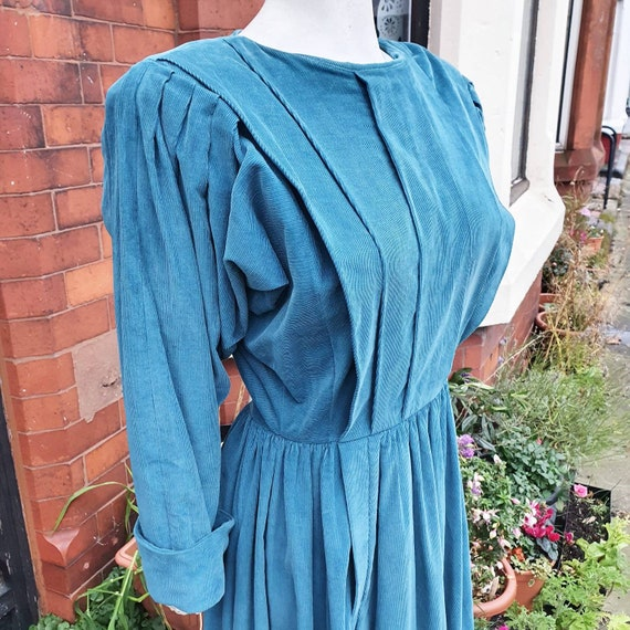 Stunning late 1970s early 80s turquoise droopy and