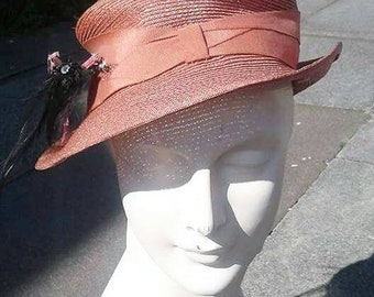 Stunning peachy pink 1930s straw hat with feather trim
