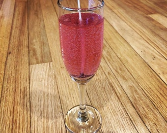 Pink Champagne Scented Long Lasting Gel Candle in Flute Glass you can keep.  Comes in three bubbly scents.