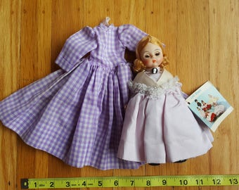 """Madame Alexander 8-inch 1960s """"Little Women"""" Meg doll along with Meg's signature white-and-lavender-checked dress for the 11-inch Meg doll"""