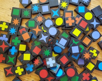 Qwirkle. Say it outloud. Now say it a couple of more times. (Still outloud.) Don't you feel just a little better? Pretty amazing.