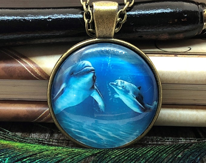 Dolphin with Baby Swimming in Ocean Bronze Dome Glass Pendant with Chain Necklace