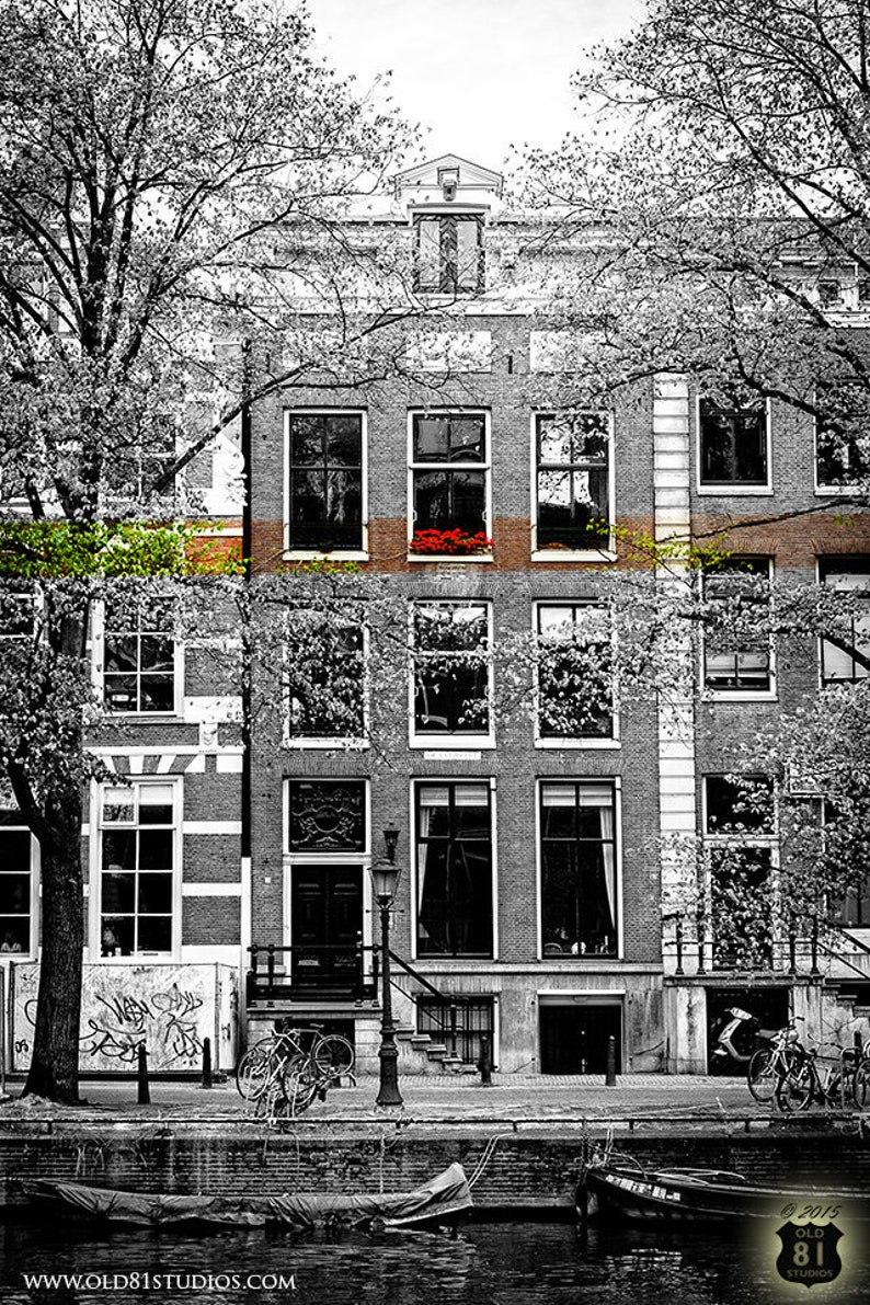 Amsterdam cityscape in black and white with color stripe red image 1