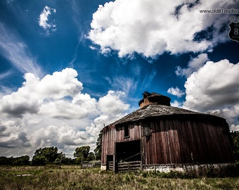 Old Iconic Rustic Round Barn that resides on a Kansas farm with a gorgeous deep blue sky white clouds in vivid color,Round Barn,Kansas, USA
