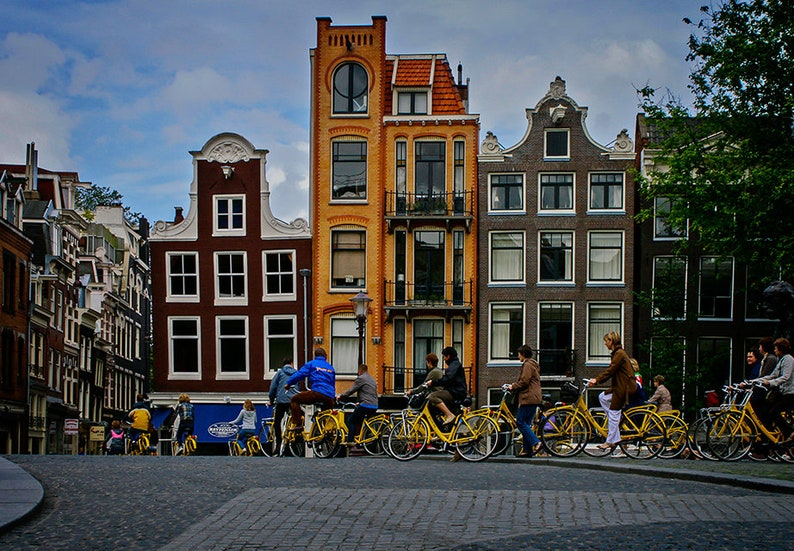 Yellow bicycles in Amsterdam cityscape in color group of image 1