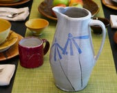 Handmade large water pitcher with cone flower pattern