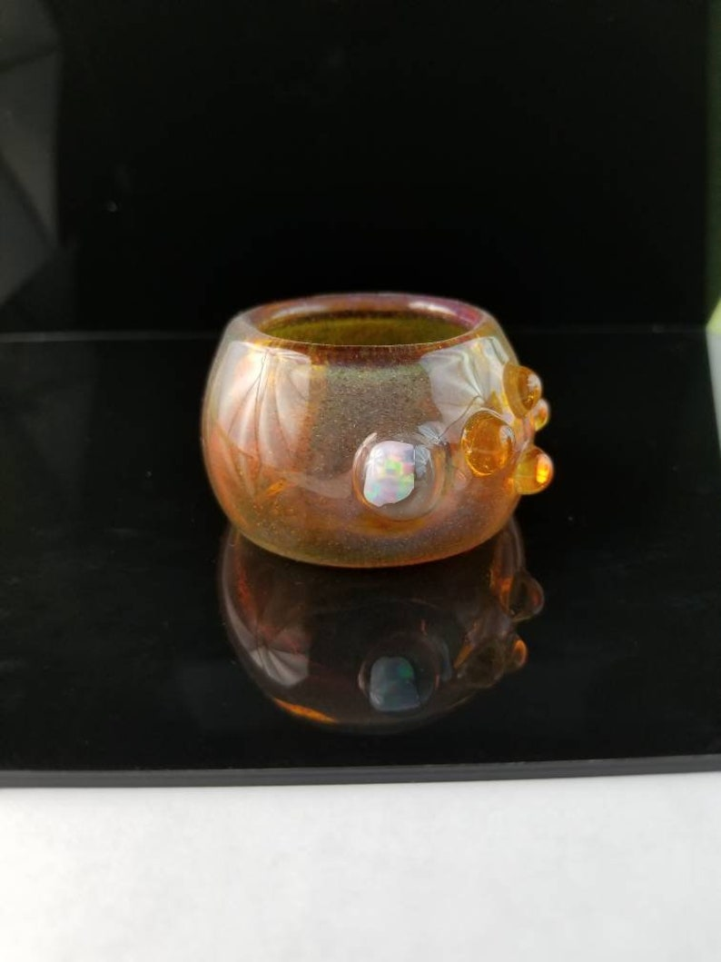 Glass jewelry dish with opal adornment