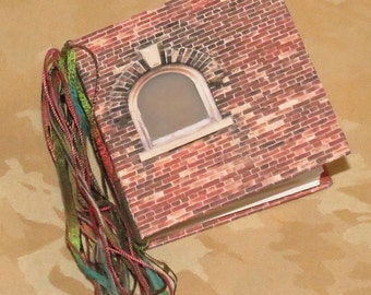 """Journal/Blank book. Tied binding. Use as scrapbook, memory book, address book. This one is """"Windows in the Wall""""."""
