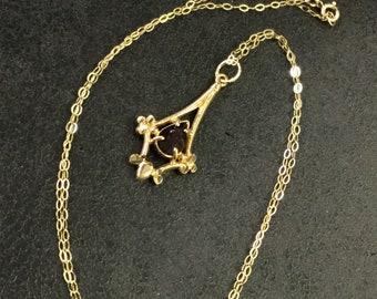 Gold garnet pendant and chain