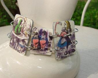 Alice in Wonderland, Cheshire Cat, Tweedledee, Tweedledum, and more lightweight resin 5 picture links bracelet.  Great gift idea or keep.