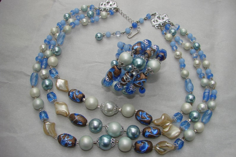 SET  Lovely necklace and cuff bracelet Great for any occasion. Mid century classic three stranded blue and cream tones glass beaded set