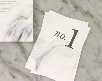 Marble Ice Table Numbers Wedding Stationery with ice blue, gray, and white marbled tones