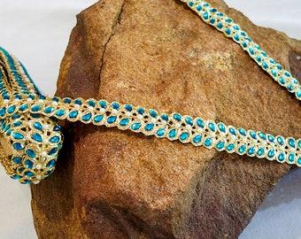 Golden trim with turquoise leaf like rhinestones