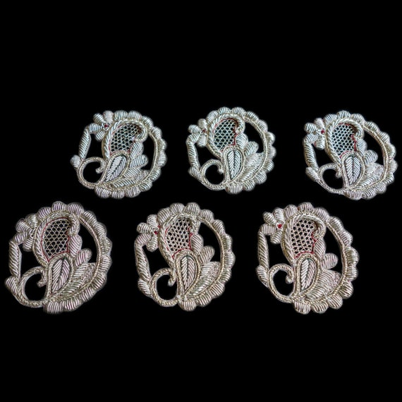 Intricately Decorated Ivory and Red Scroll Appliques with multiple cut outs