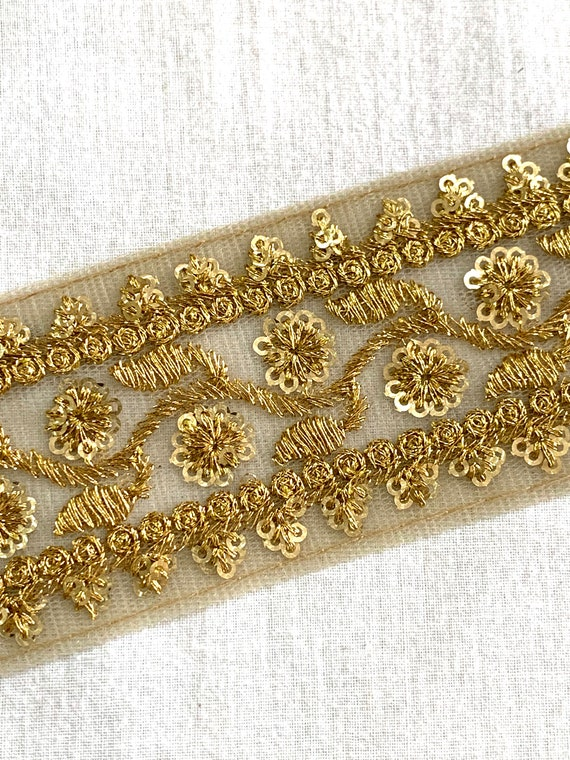 Embroidered with gold fine sequins and gold metallic thread on beige net