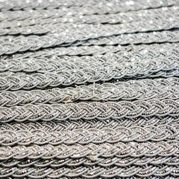 Small metallic silver simple bordered braid trim