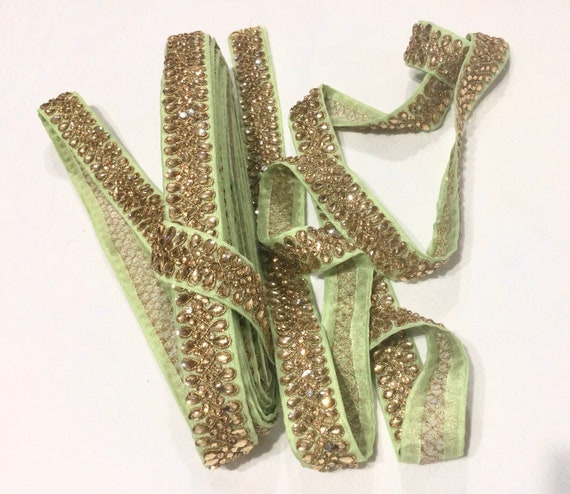 Green trim with golden crystals and rhinestones