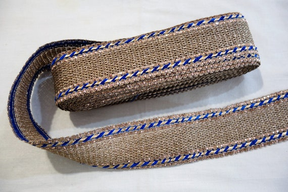 golden woven threads trim bordered with blue silken thread and ribbon