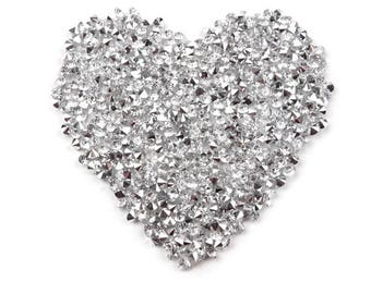 Applied fusible adhesive rhinestones heart