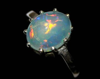 50% Off A Magical 9 x 11 MM  Natural Ethiopian  Opal Ring with a stunning  set in sterling silver Size is ( US 7 ) 0051