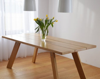 Handmade solid wood dining table. Contemporary design
