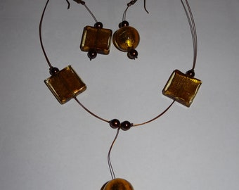 Adornment necklace and asymmetrical earrings with Golden glass beads and chocolate brown beads