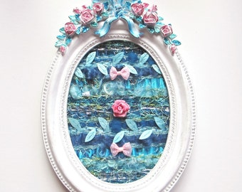 Textile art, Textile painting, shabby chic weaving in an oval white frame with a blue and pink baroque decoration