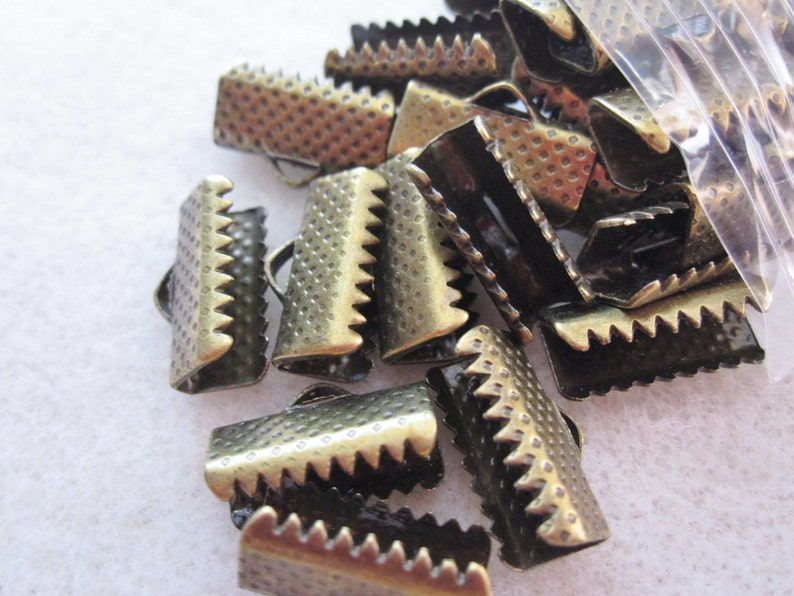 50-16mm Silver and Bronze Ribbon Crimp Ends with Loop.