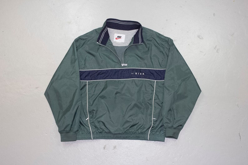 4ebd52f0afeb3 vintage 90s NIKE windbreaker jacket - green + navy blue - mens L