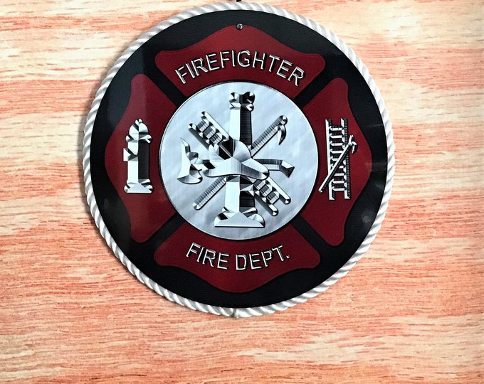 Firefighter round metal sign on wood