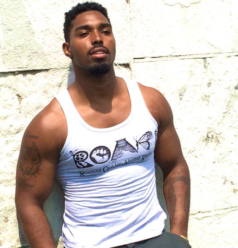 0cd7b704e0010 Tank Top  Front says ROAR Back says