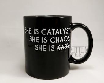 She Is Catalyst She Is Chaos Coffee Mug   Kady Grant   AIDAN error   The Illuminae Files   Amie Kaufman   Jay Kristoff   Bookish Merch