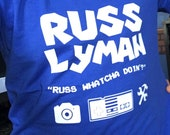 official russ lyman shirt Whatcha Doin slogan (White Lettering)