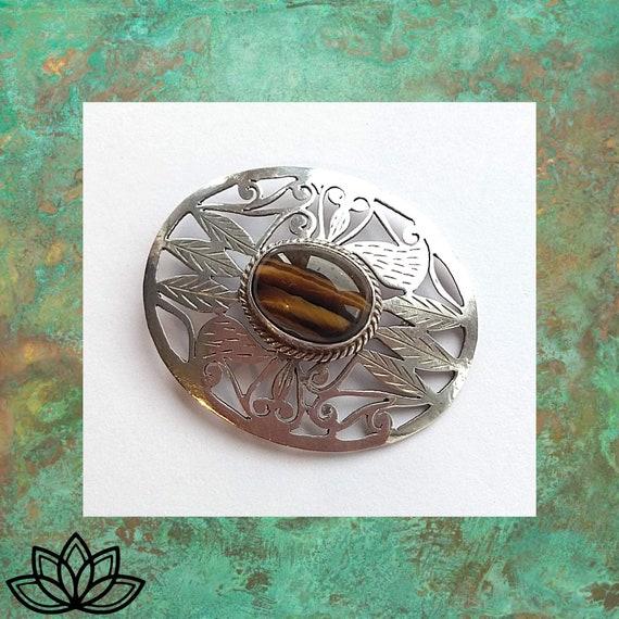 Vintage pin protection gemstone trend, tigers eye fashion brooch