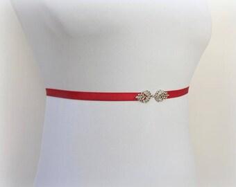 Red elastic waist belt. Thin belt. Skinny dress belt. Silver filigree belt. Stretch belt.